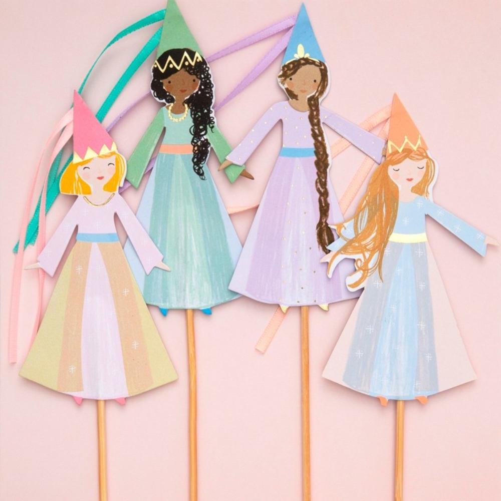 A set of 4 princess-shaped cake toppers