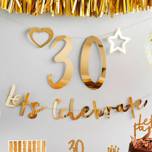"A customisable party banner with gold foil writing and a phrase saying ""Let's celebrate"""
