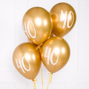 "A bunch of metallic gold latex milestone party balloons with a number ""40"" on it"
