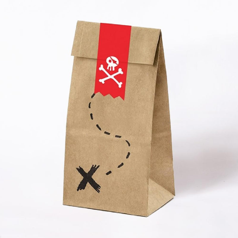 A brown paper party bag with pirate-themed doodles