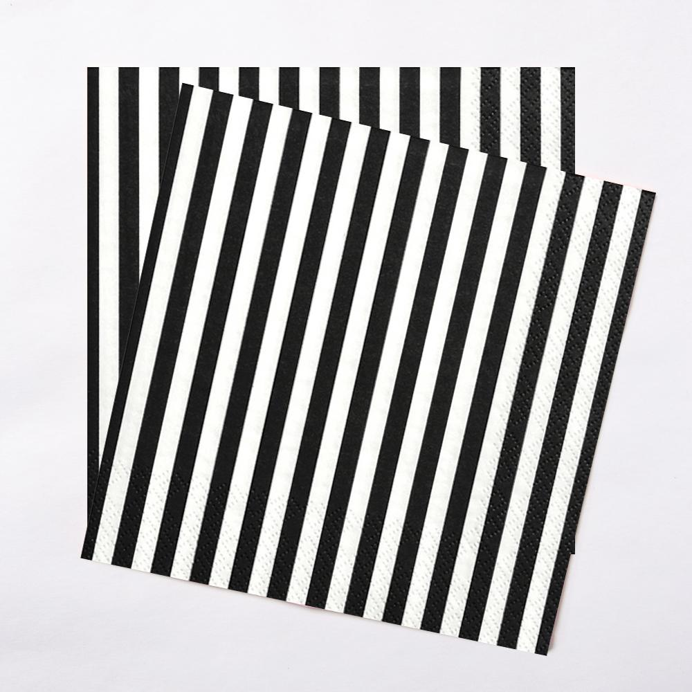 A pair of black and white pirate paper party napkins