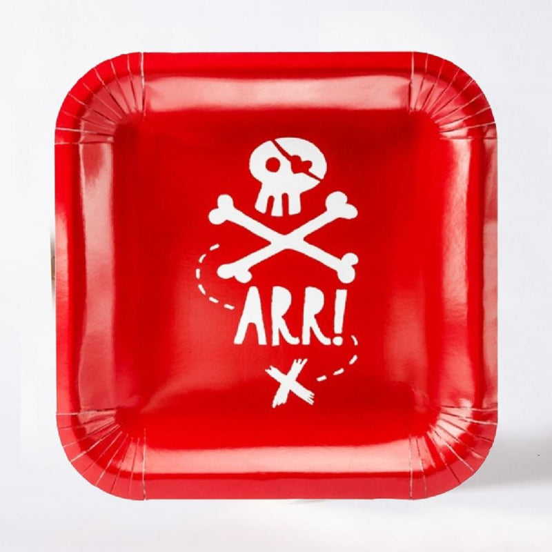 A square, red pirate party plate with a skull and crossbones design
