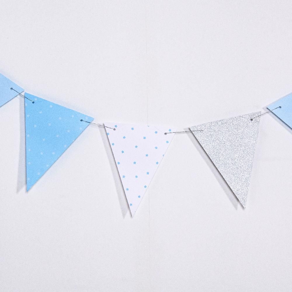 A 1st birthday party bunting with blue and white flag pennants
