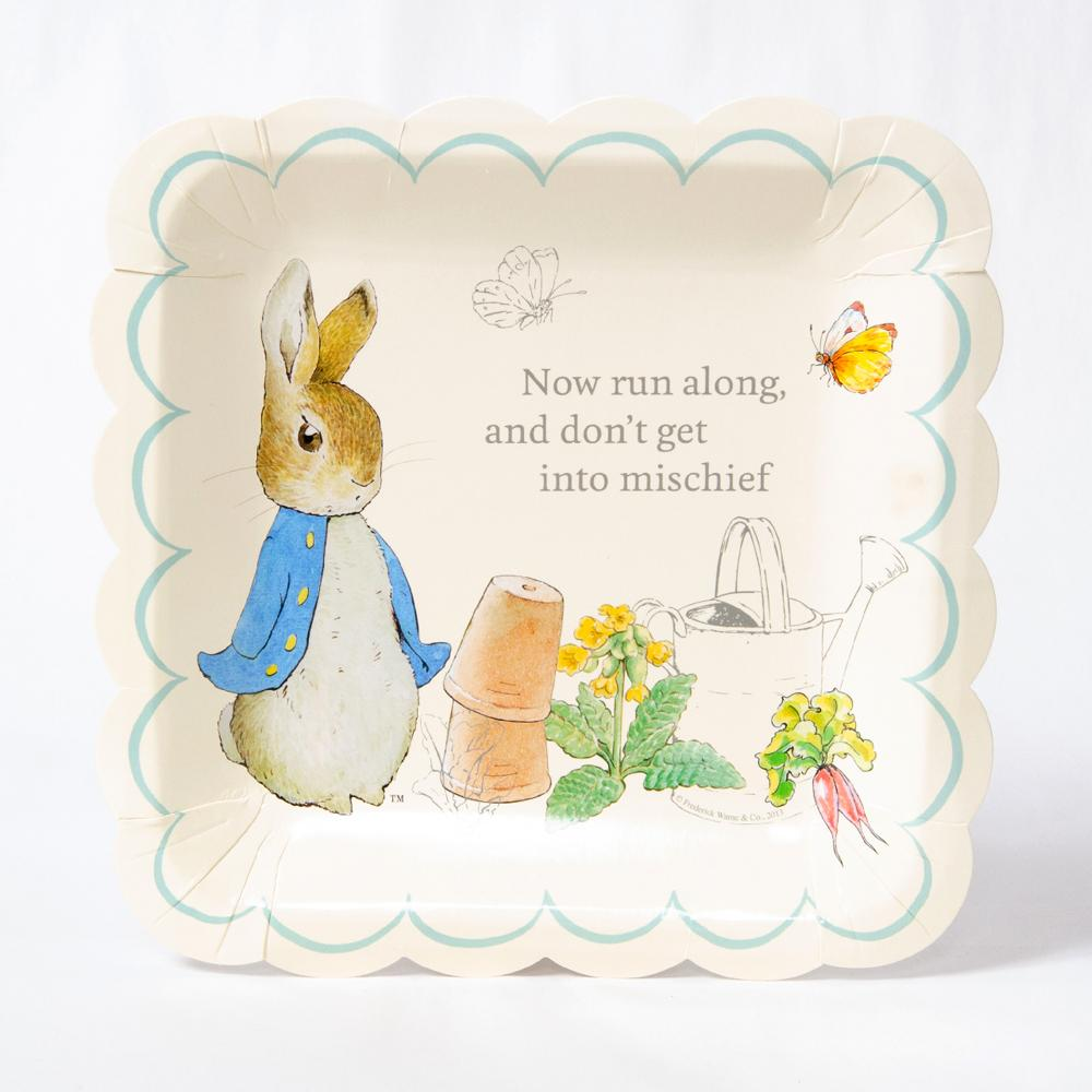 A square party plate with a scalloped-edge and Peter Rabbit design