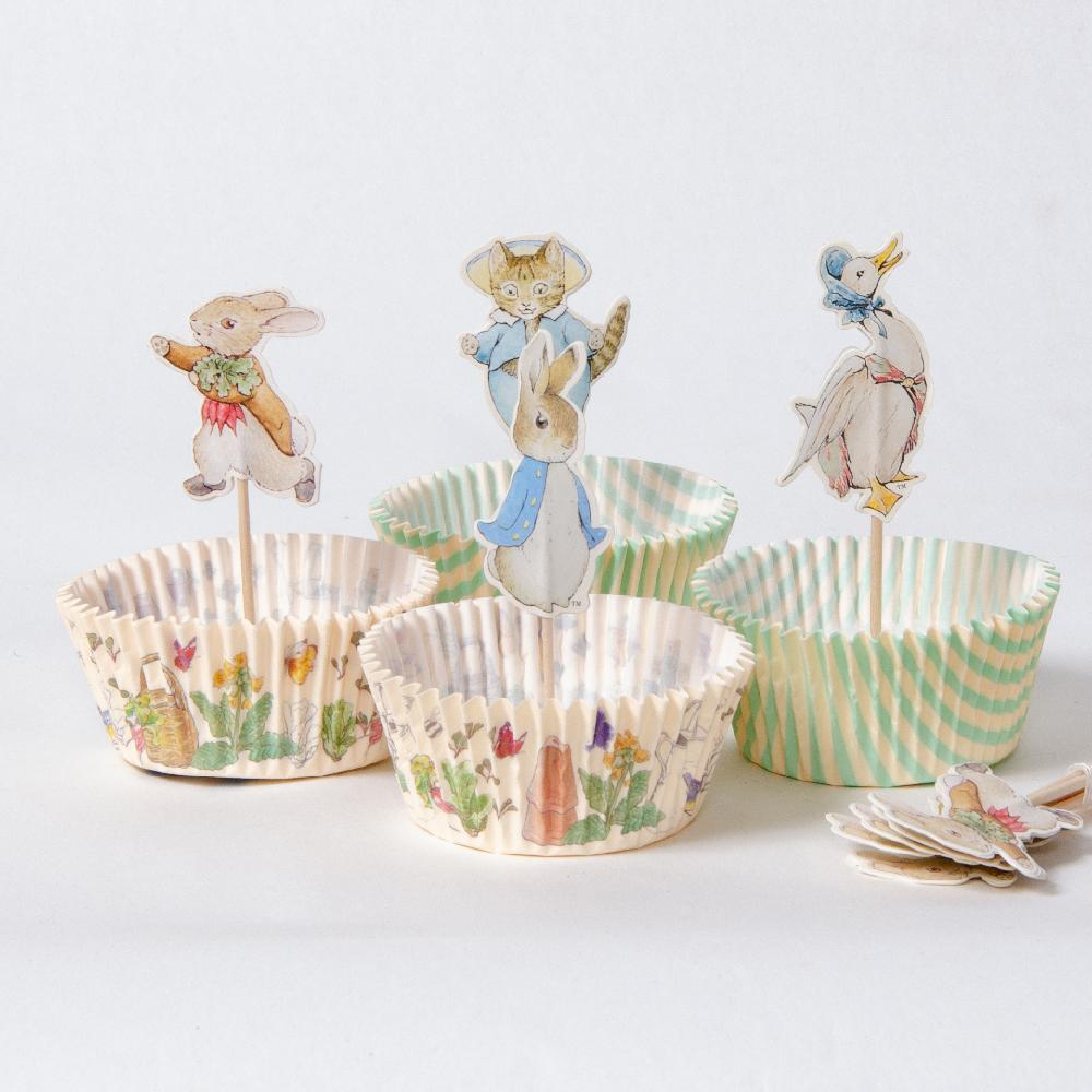 A set of Peter Rabbit-themed cupcake bases and toppers