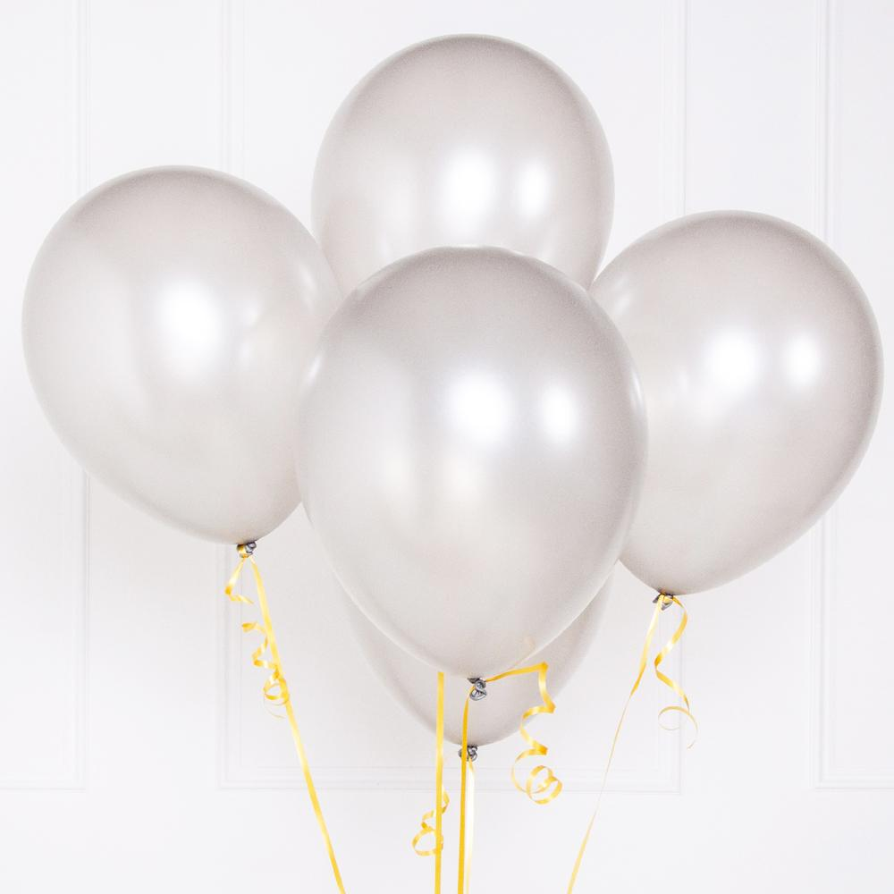 5 metallic silver party balloons floating in a bunch