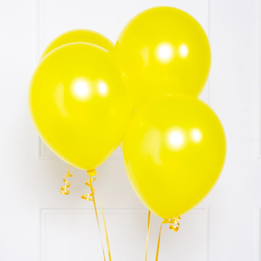 A bunch of 5 yellow metallic party balloons