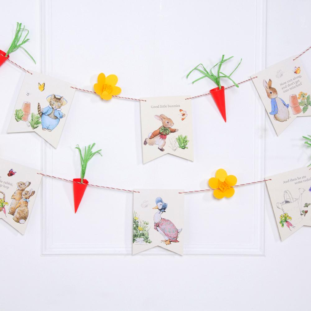 A Peter Rabbit-themed party garland with Carrot cut outs and floral flag pennants