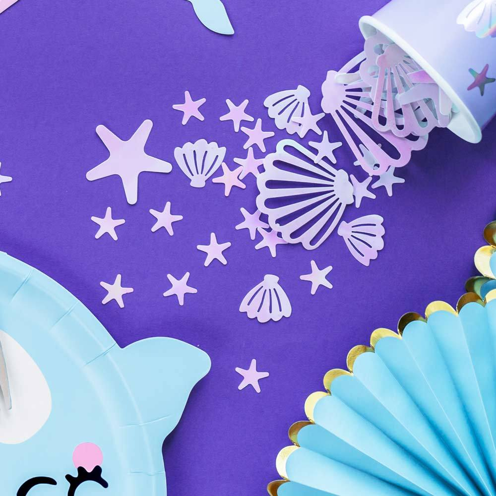 Click to view product details and reviews for Iridescent Sea Shaped Confetti.