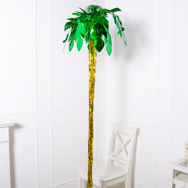 A large 8 foot tall palm tree decoration with green foil leaves and a gold foil trunk
