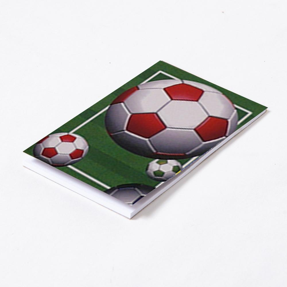 A small memo pad featuring a football pitch and ball illustration on the front