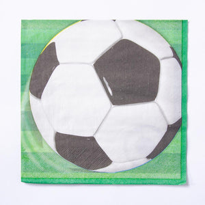 A football party napkin with a green pitch and ball design