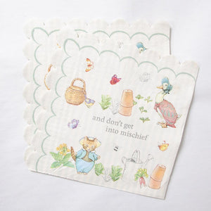 A set of Peter Rabbit paper party napkins with a scallop design