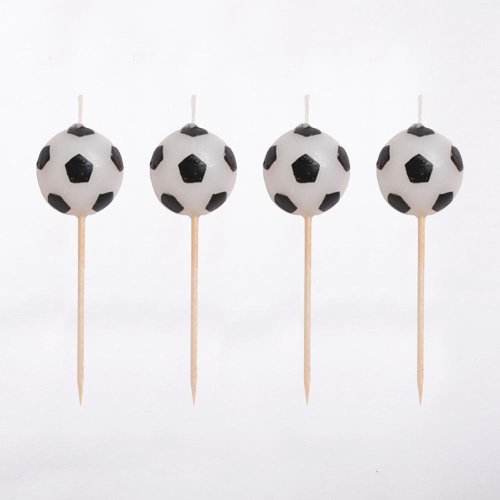 4 football-shaped party cake candles with wooden picks