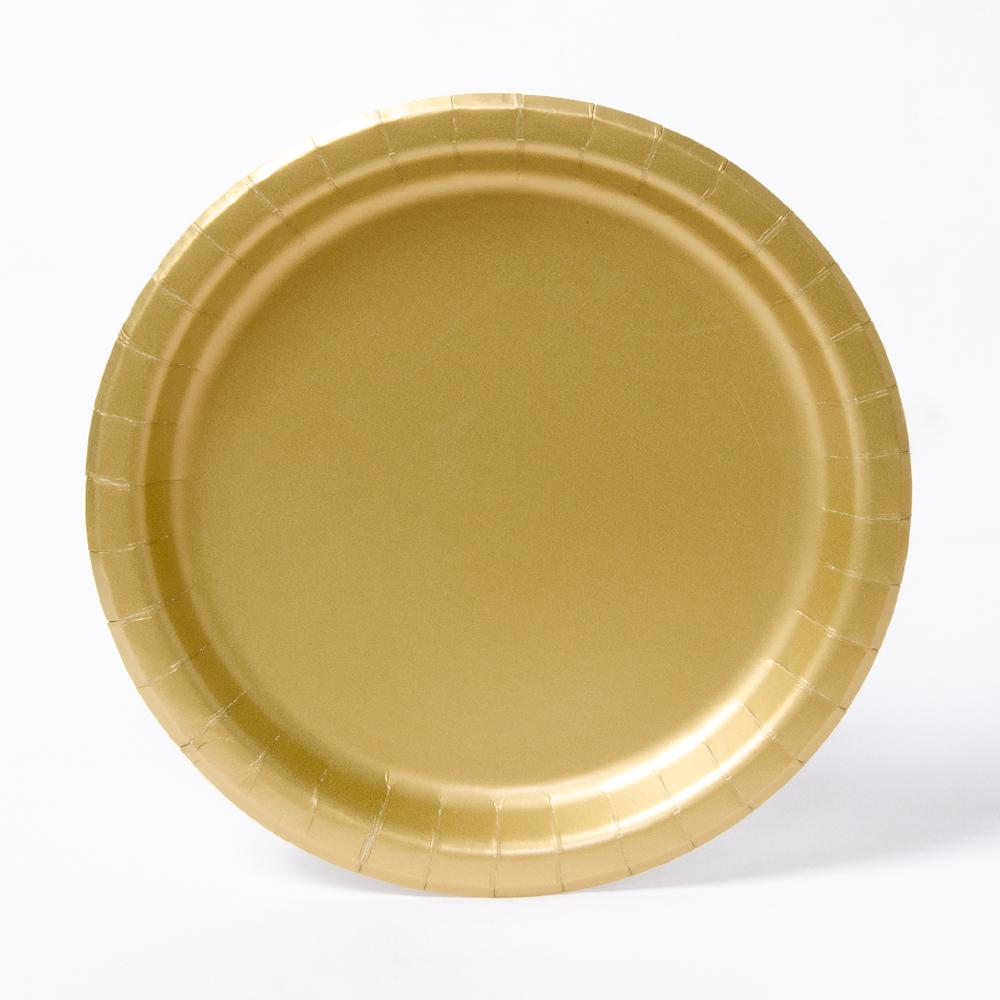 A round paper party plate in a matte gold colour