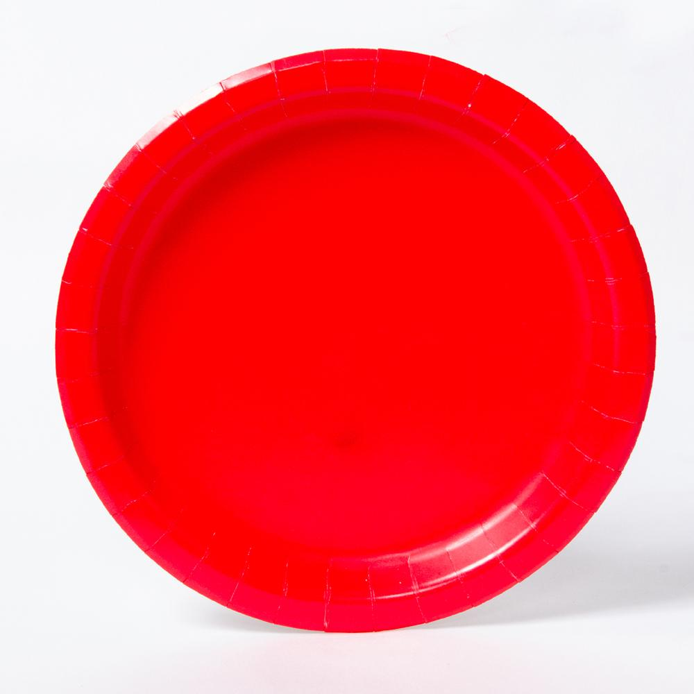 A round paper party plate in a bright red colour