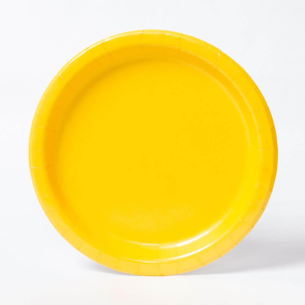A round paper party plate in a bright yellow colour