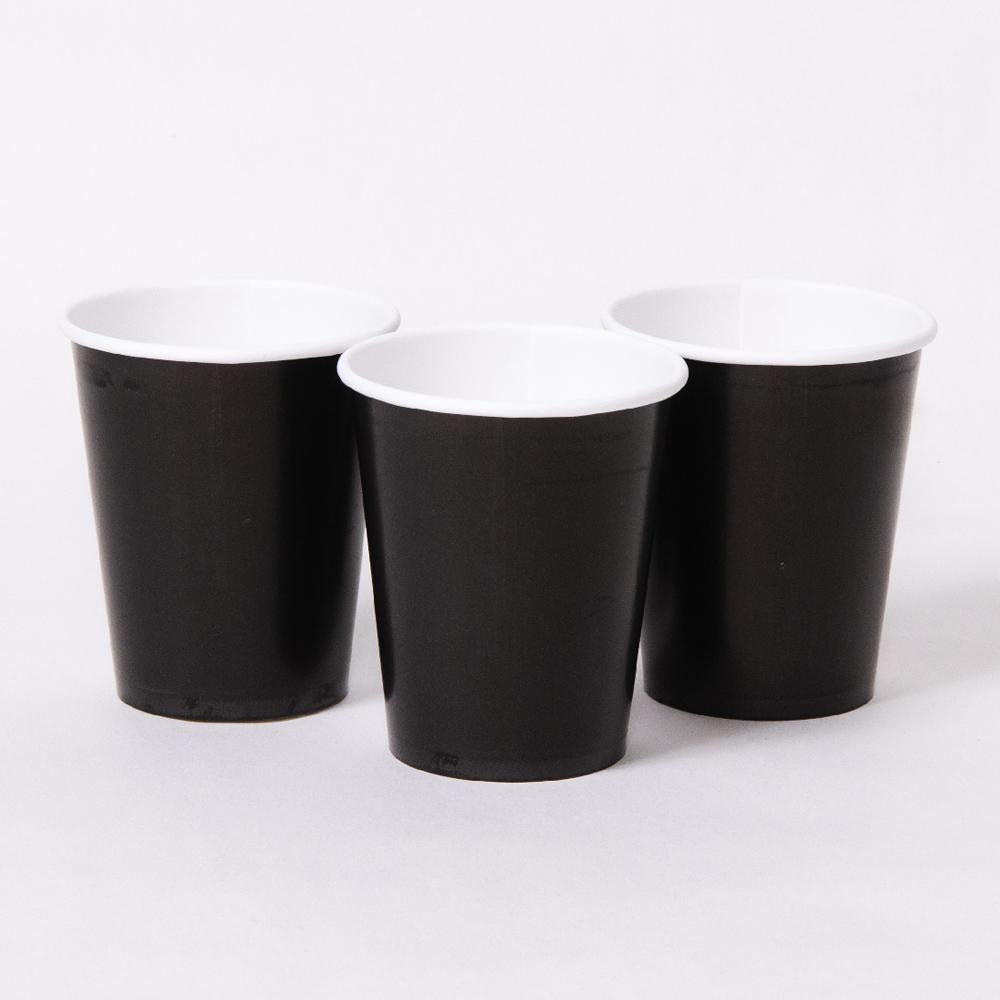3 black paper party cups with white rims