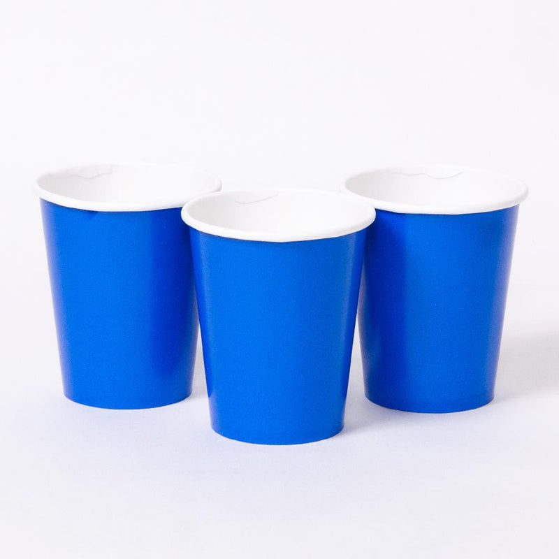 3 bright blue party cups with white rims