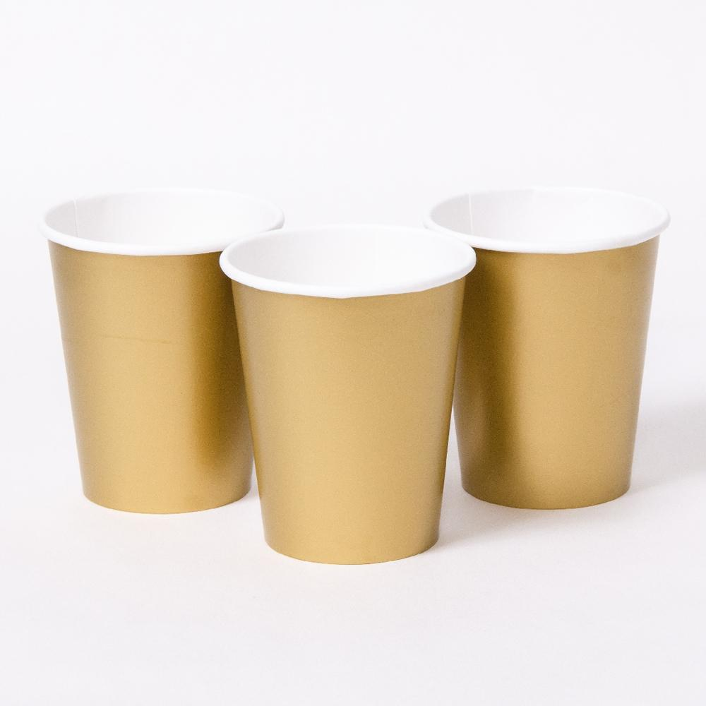 3 matte gold party cups with white rims