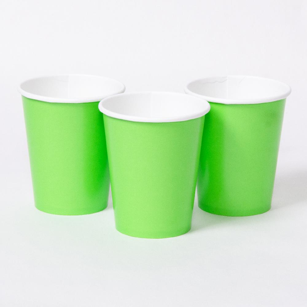 3 bright green party cups with white rims