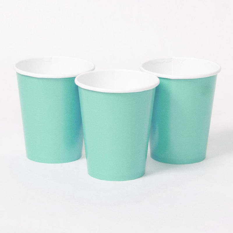 3 mint green party cups with white rims