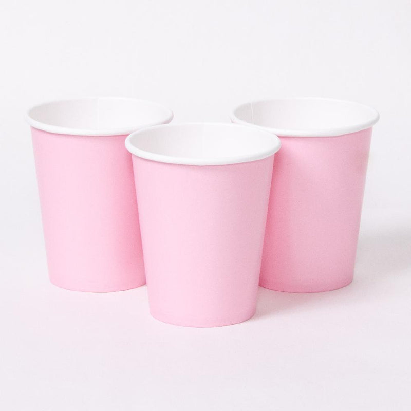 3 pale pink party cups with white rims