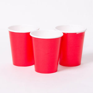 3 bright red party cups with white rims