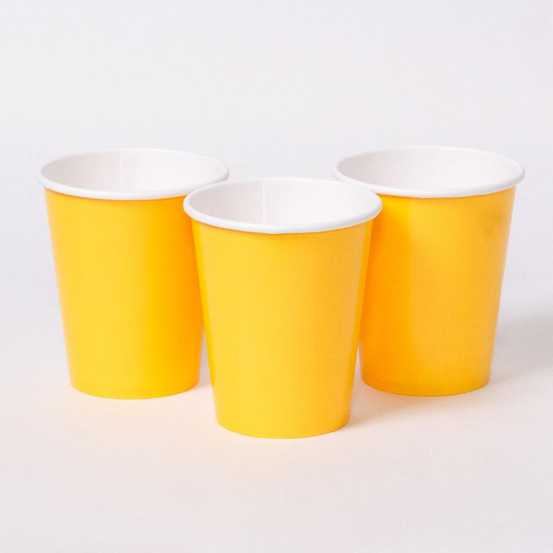 3 yellow party cups with white rims