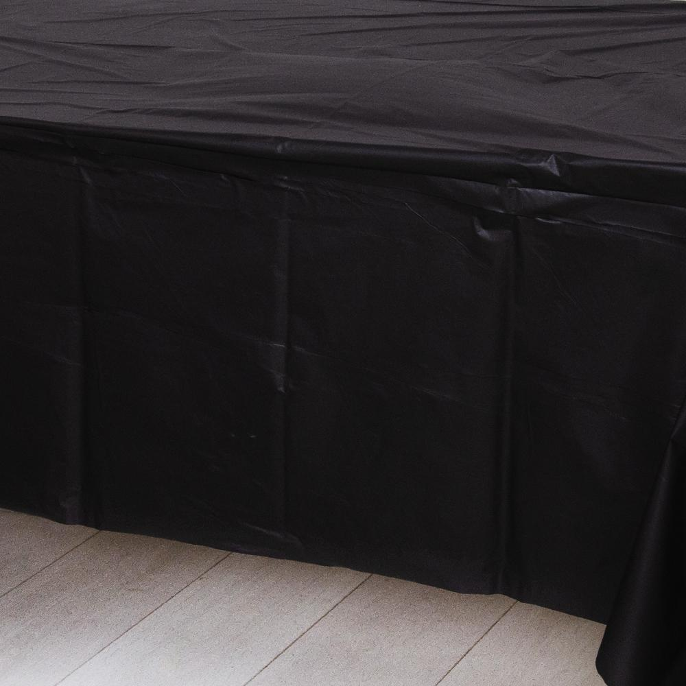 A black plastic party table cover