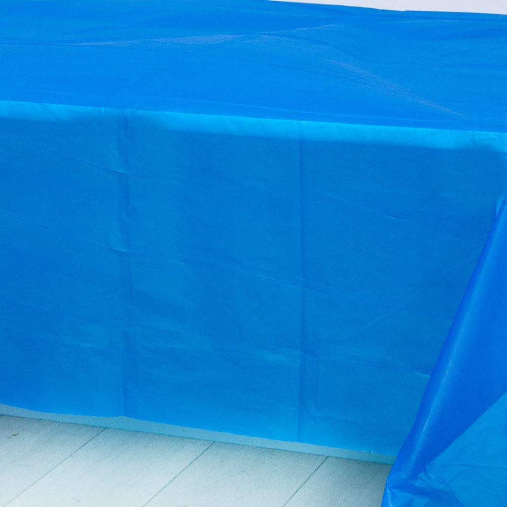 A royal blue plastic party table cover spread over a table