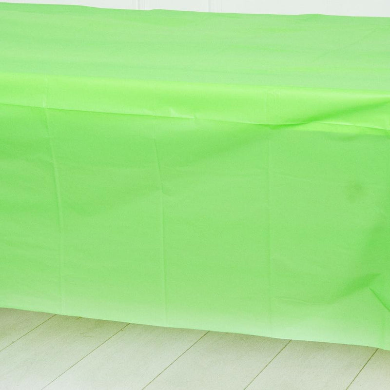 A green plastic party table cover spread over a table