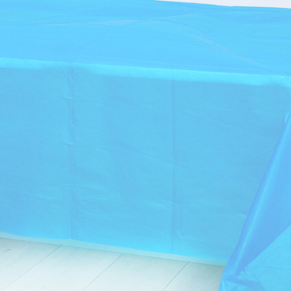 A pale blue plastic party table cover spread over a table