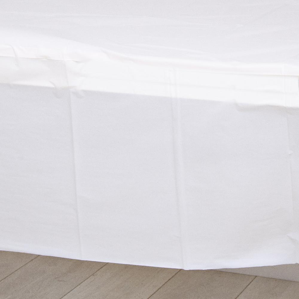 A white plastic party table cover spread over a table