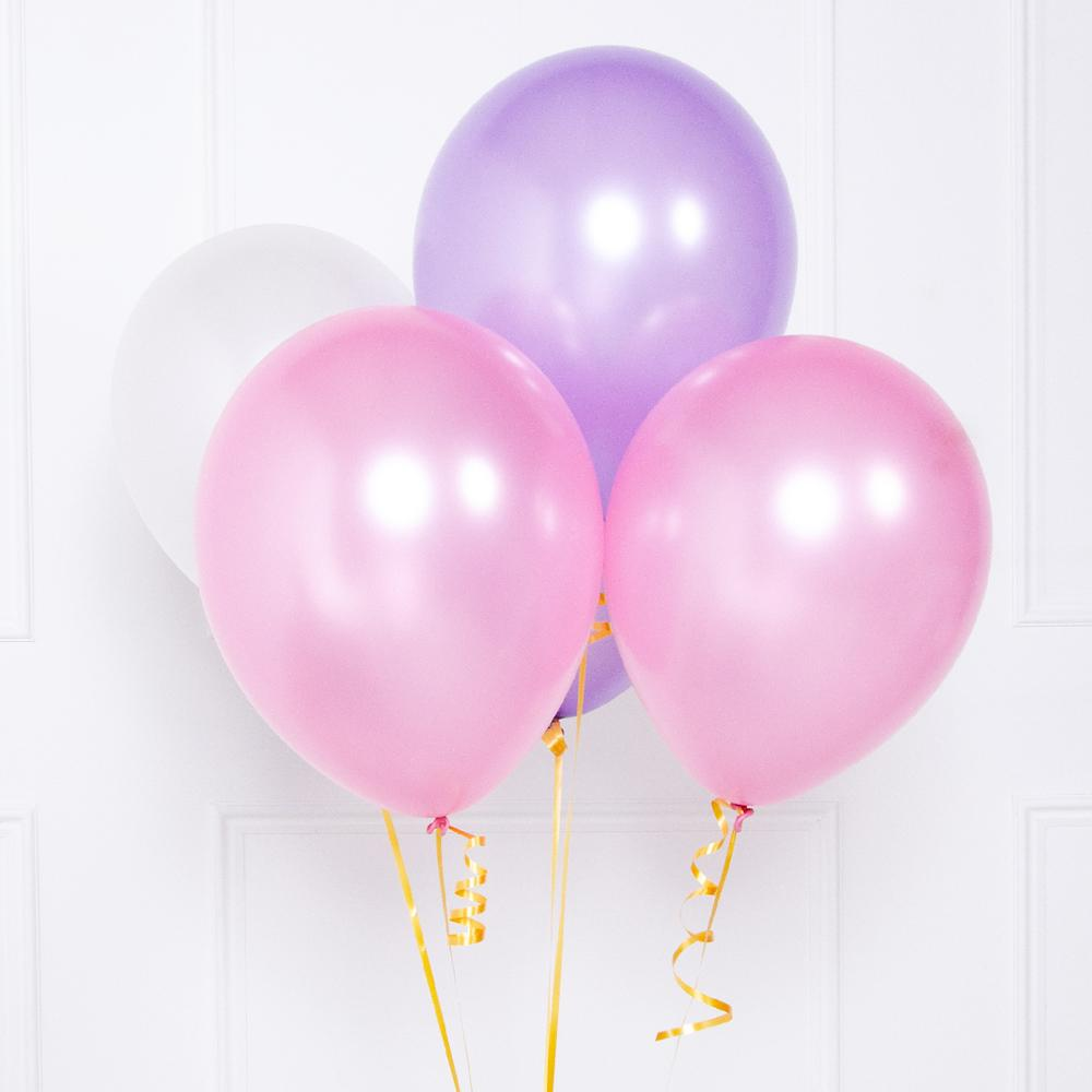 A bunch of soft pastel-coloured latex party balloons