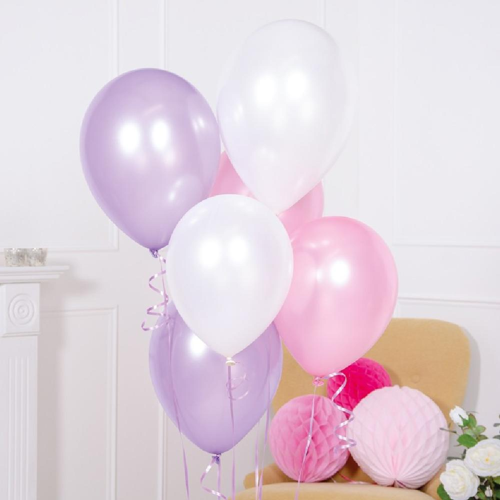A bunch of soft pastel-coloured latex party balloons at a party