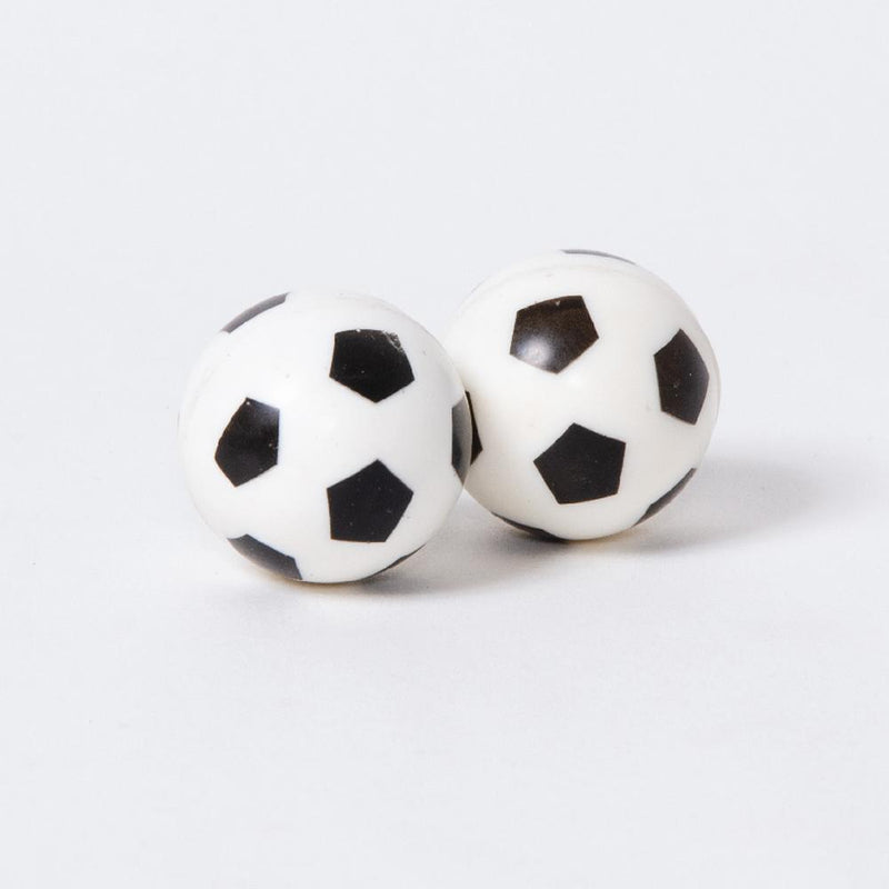 A pair of bouncy balls in the shape and stlye of the classic black and white football