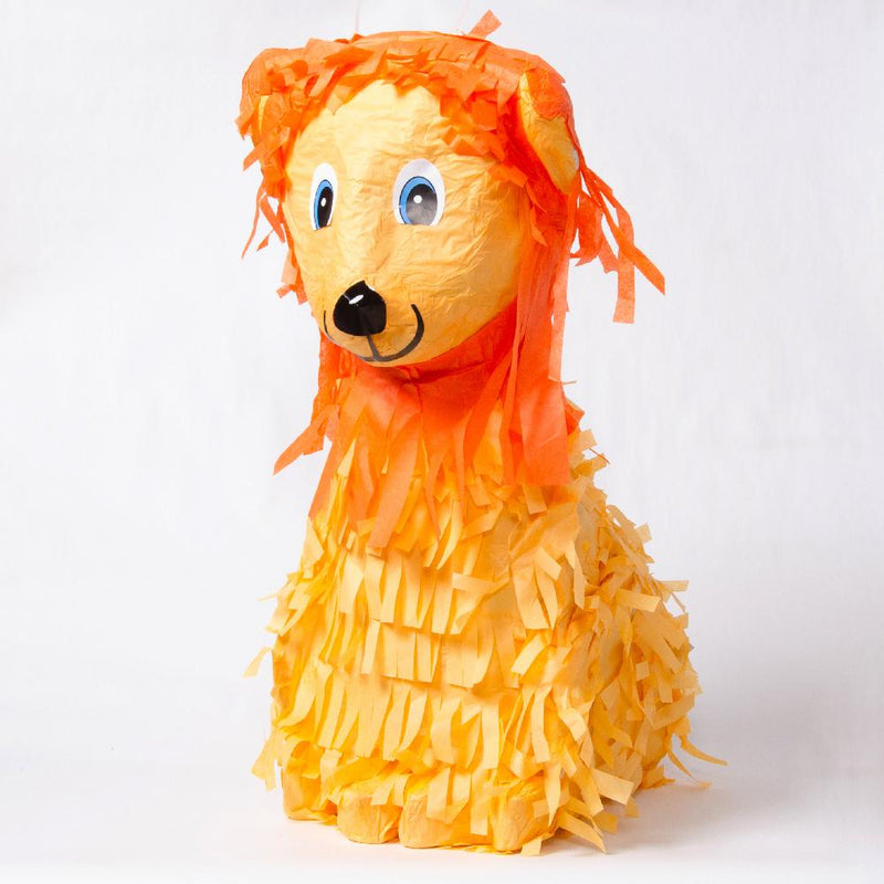 A lion-shaped pinata with a smiling face and fluttery tissue tassels