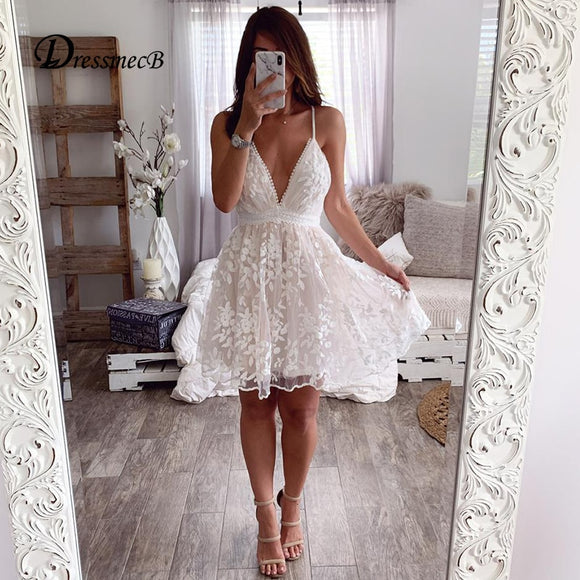 White Lace Casual Dress 2020 Women Autumn Spaghetti Strap Deep V Neck Dress 2020 White Backless Dress Sleeveless Sexy Dress Club Elegant Night Party Dress