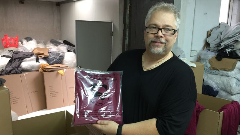 Big Boy Bamboo model Andrew shows us the finished t-shirt ready to be boxed and shipped to our warehouse.
