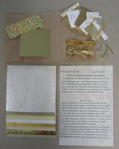 Paper bag book kit contains instructions, 3 lunch bags, fasteners, trim & enough gold color-themed specialty papers to make one book