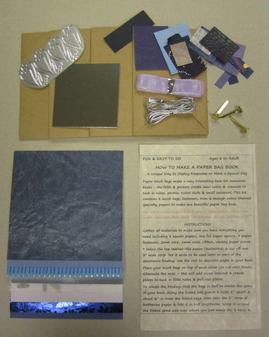 Paper bag book kit contains instructions, 3 lunch bags, fasteners, trim & enough purple color-themed specialty papers to make one book.