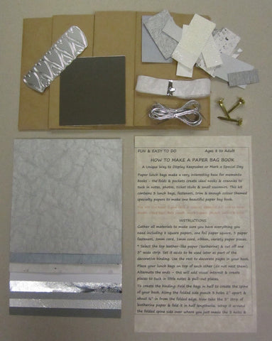 Paper bag book kit contains instructions, 3 lunch bags, fasteners, trim & enough silver color-themed specialty papers to make one book