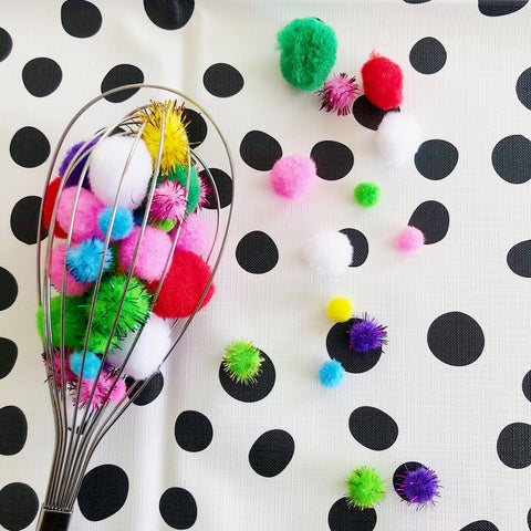 baby sensory play idea whisk with colourful pom poms