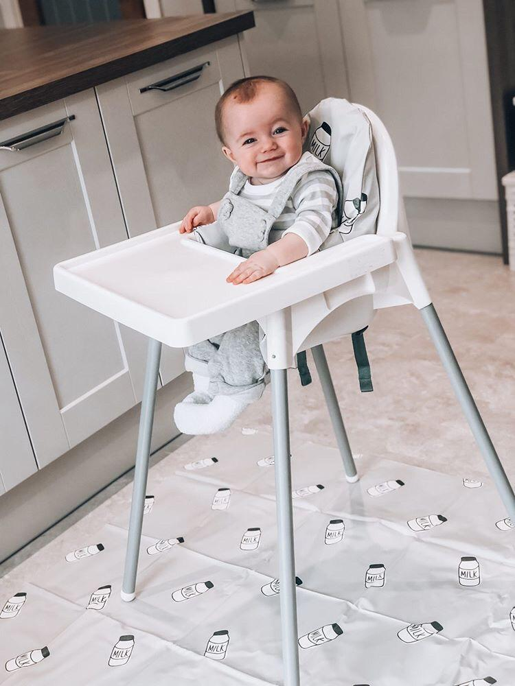 baby boy in IKEA ANTILOP highchair with grey milk cushion cover and matching splash mat