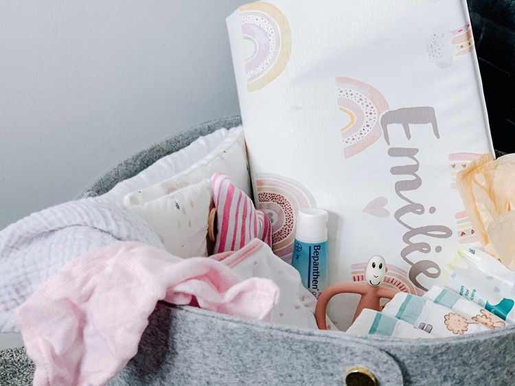 personalised earth tone baby changing mat in changing caddy