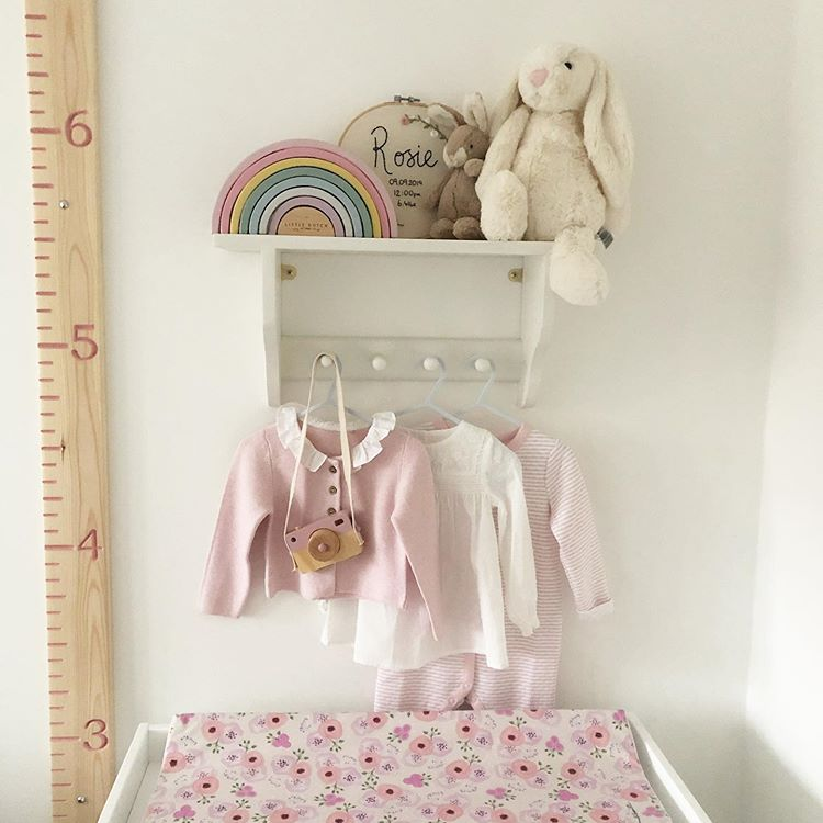Baby girls nursery changing table and shelf with pink floral changing mat