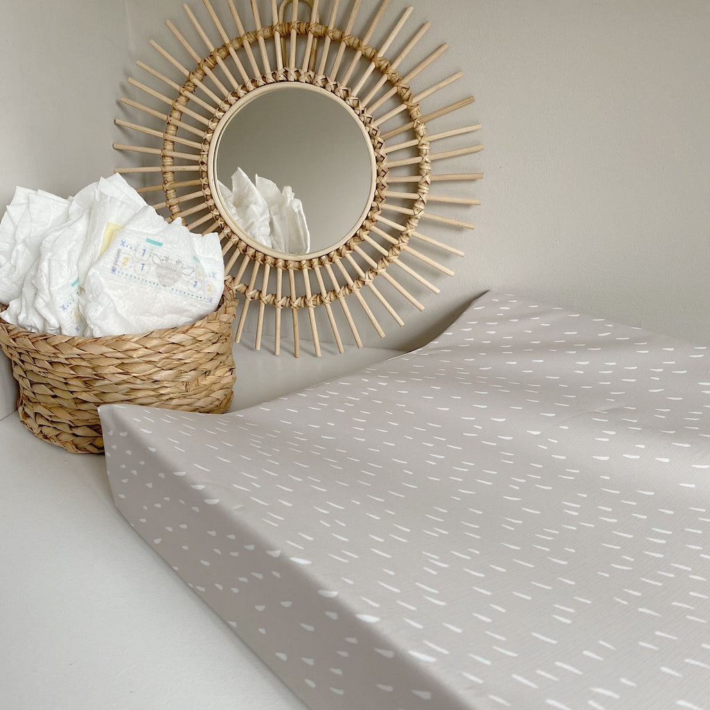 bobbin-and-bumble's Anti-Roll Wedge Changing Mat - Beige Dash Print.