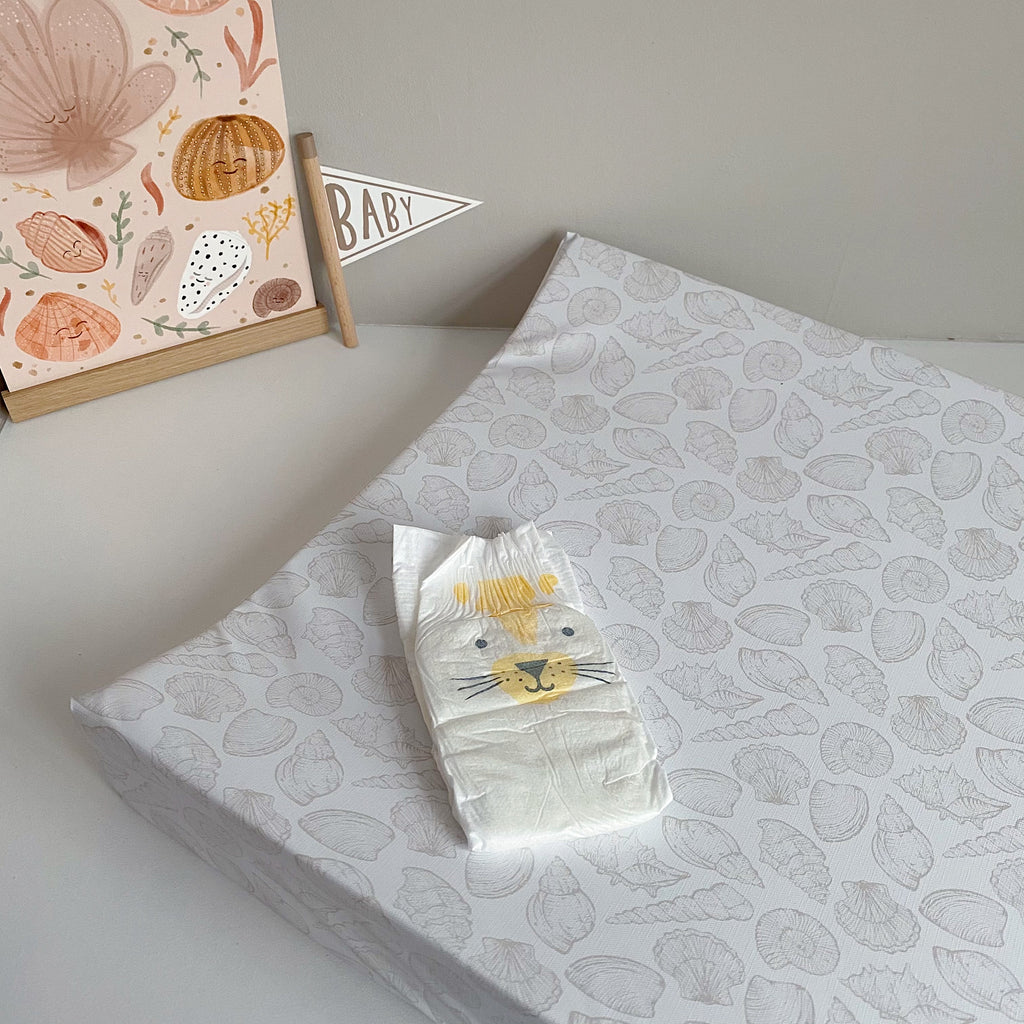 bobbin-and-bumble's Anti-Roll Wedge Changing Mat - Delicate seashell print.