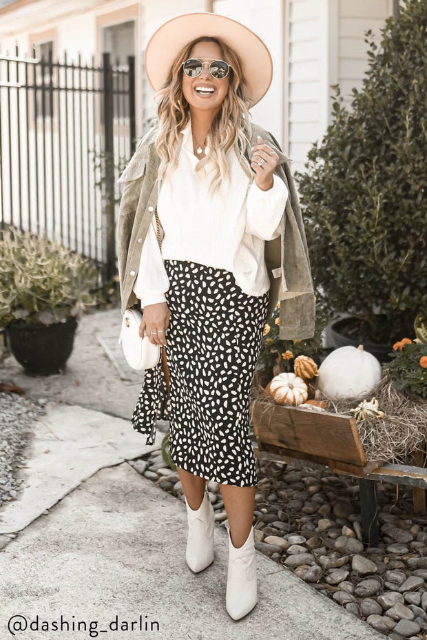 WALK ON THE WILD SIDE BLACK AND IVORY ANIMAL PRINTED MIDI SKIRT